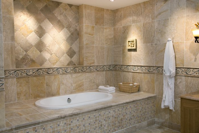 Bathroom setting with assorted traditional tiled areas